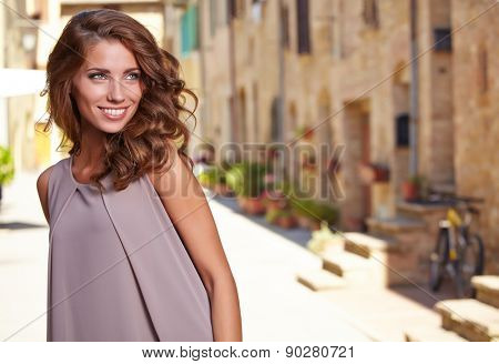 Beautiful woman on the streets of the old Italian town