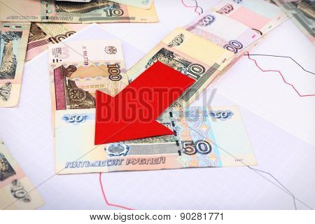 Money and red arrow on graph document close up