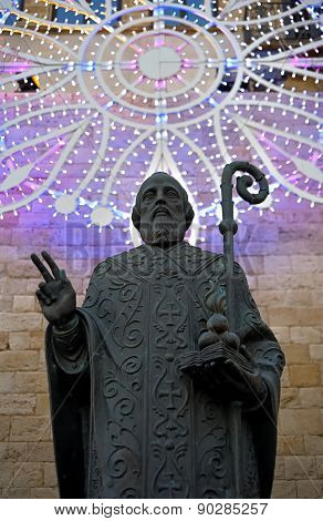 Bronze statue with luminaria of St. Nicholas