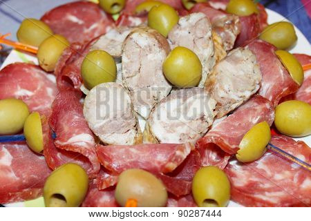 Sausage Cutting Into Pieces And Olives