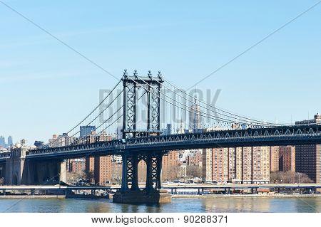 Manhattan Bridge and skyline view from Brooklyn Bridge in New York City