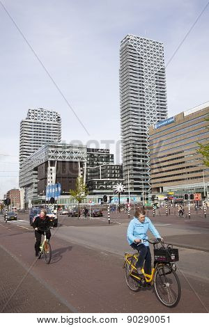People On Bike In Front Of New Babylon In The Hague
