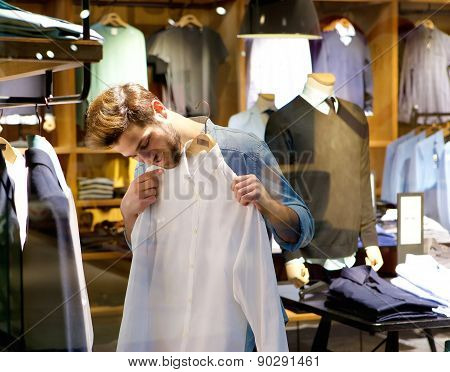 Handsome Young Man Shopping For Clothes