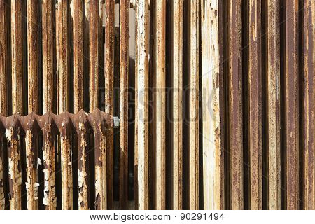 Rusty Radiator With Cracked White Paint