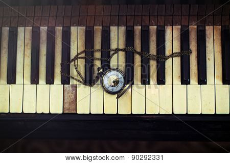 Vintage Piano Keys With Antique Pocket Watch With A Chain - Time Concept
