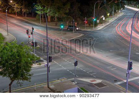 Single Car Waiting At The Lights