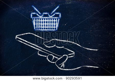 Hand Holding Mobile Phone With Glowing Shopping Cart