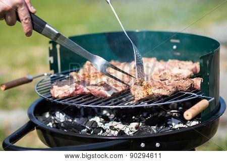 grilling pork on live coals