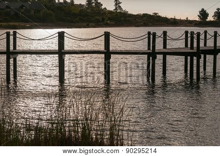 Silhouette Of A Jetty In A Dam