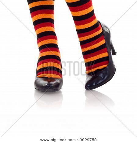 Feet Wearing Colored Socks In High Heels