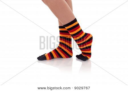 Woman Legs In Strip Socks