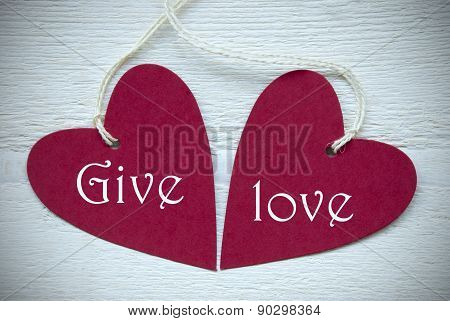 Two Red Hearts With Give Love