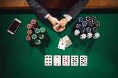 image of poker hand  - Elegant male poker player - JPG