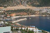 stock photo of marina  - A view of Kalkan from the hillside looking towards the marina - JPG