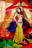 stock photo of harem  - Young oriental beauty is in front of the tent - JPG