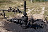 picture of oil well  - Spilled crude oil around oil field - JPG