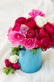 pic of bunch roses  - bunch of fresh pink  ranunculus and rose flowers  in blue pot - JPG