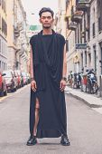 image of tunic  - Young handsome Asian model dressed in black tunic posing in the city streets  - JPG