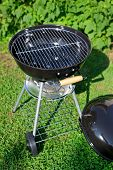 stock photo of kettles  - Kettle barbecue grill in summer garden outside nobody