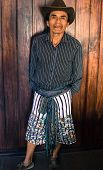 stock photo of mayan  - picture of Mayan man in Guatemala wearing  traditional woven  belt, embroidered shorts, and hat ** Note: Soft Focus at 100%, best at smaller sizes - JPG