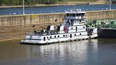 image of barge  - Barge with Lock Wall on a River - JPG