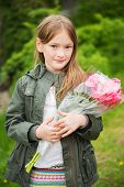 stock photo of khakis  - Outdoor portrait of a cute little girl - JPG