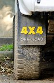 picture of four-wheel drive  - Dirty off road vehicle tireclose up view - JPG
