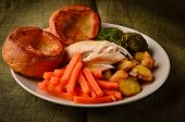 stock photo of grub  - Chicken Sunday Dinner With Yorkshire Puddings on a rustic hessian background - JPG