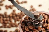 pic of wooden box from coffee mill  - Closeup picture of coffee bean grinder and coffee bean - JPG