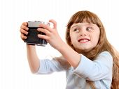 picture of girlie  - Cheerful Little Girl make a Selfie with Retro Photo Camera on the White Background - JPG
