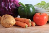 picture of root vegetables  - vegetables on wooden chopping board prepare cooking - JPG