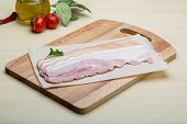 pic of bacon strips  - Raw Bacon strips on the wood background - JPG