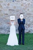 picture of crazy face  - Newlywed couple acting funny with white cartons of  - JPG