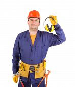 stock photo of muff  - Worker in hard hat holding ear muffs - JPG