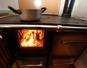 picture of ember  - wood and embers of the fireplace in the kitchen of the House in the mountains - JPG