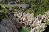 foto of reining  - bridge Pont de la Reine Jeanne Provence France - JPG