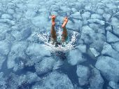 stock photo of cold-weather  - Cool down and Cooling off concept as a diver diving into frozen ice water as a symbol for managing hot weather summer heat and refreshing break from a heatwave - JPG