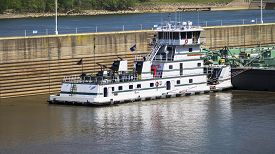 pic of barge  - Barge with Lock Wall on a River - JPG