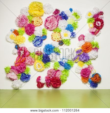 Wall of multiple colorful tissue paper flowers