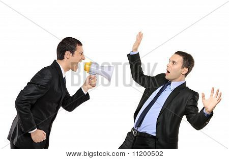 Angry Businessman Yelling Via Megaphone To Another Businessman