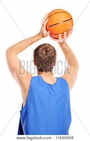 Basketball Player Aiming To Shoot A Ball