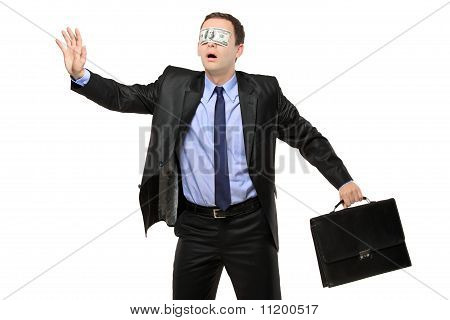 Lost Blindfold Businessman With A Dollar Banknote On His Eyes
