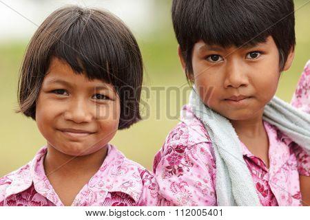 SATUN, THAILAND, DECEMBER 09, 2011 : Portrait of two Thai little girls in a social school orphanage in Satun, Thailand.