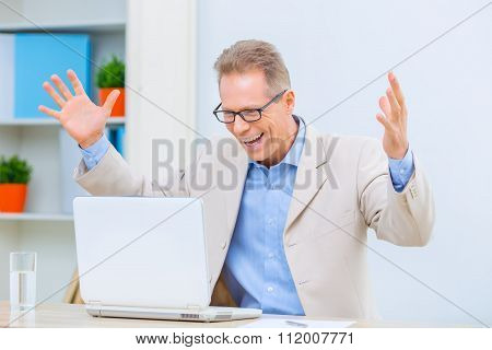 Businessman feeling glad about successful deal.