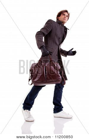 Portrait Of A Young Man With A Handbag, Hasty, In Autumn/winter Clothes, Isolated On White. Studio S