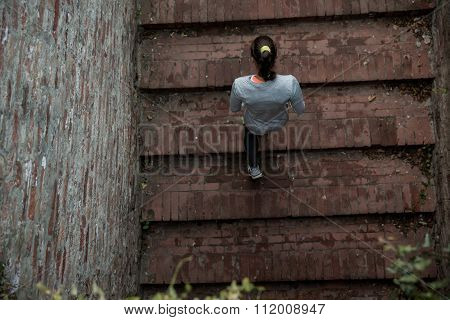 Young Woman Running Upstairs