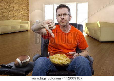 Man Watching Football At Home