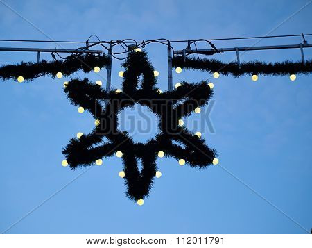 Christmas Lights Star Decoration In A Street