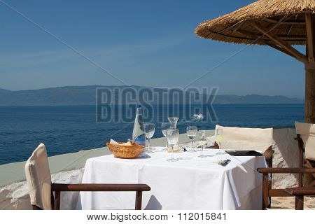 Table With Glassware At Outdoor Restaurant