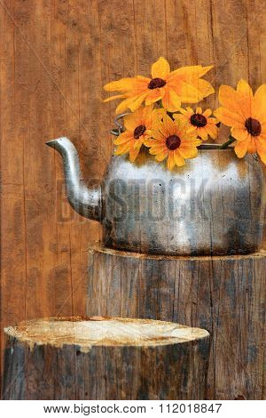 Sunflowers in an Old Tea Kettle